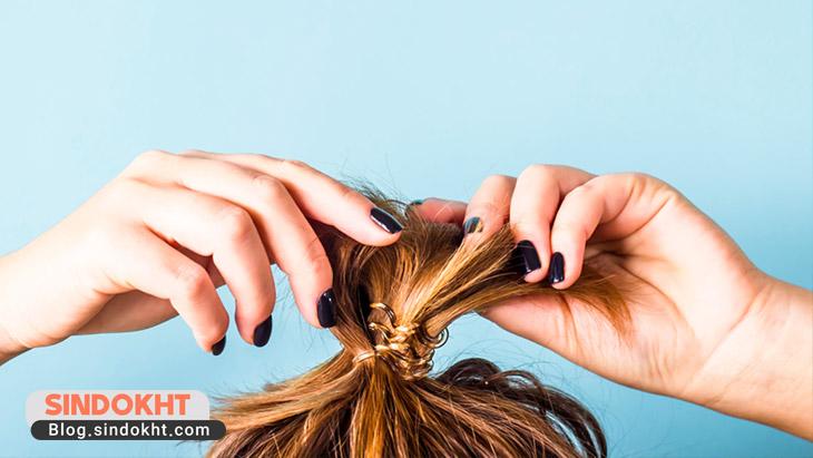 بستن مو از راه های مراقبت از مو در برابر آفتاب